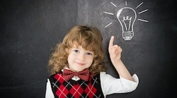 Girl pointing to a chalkboard lightbulb